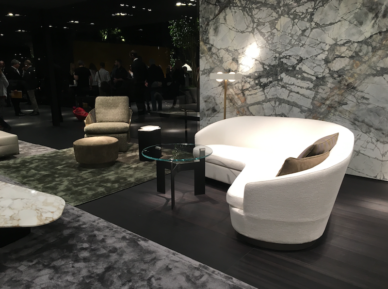 MINOTTI - Marbles, viscose, velvets and rich dark timbers were prevalent throughout the fair, Minotti does it best - the sofa pictured perfect for small spaces, comfortably seating 2-3 people with a much smaller footprint.