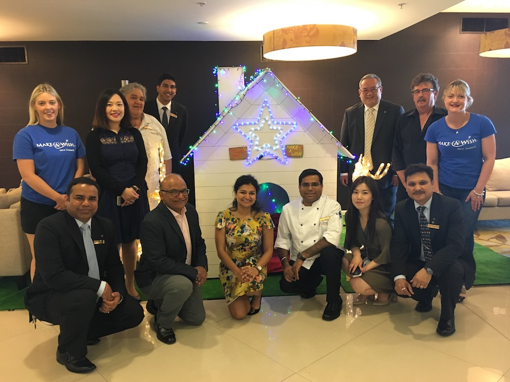 Make-A-Wish with the Sudima Auckland Airport team and the gingerbread house structure