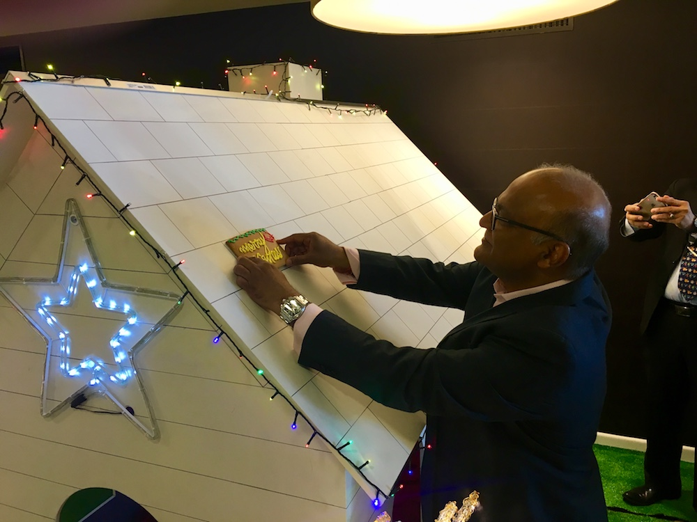 Sudima Hotels & Resorts owner Sudesh Jhunjhnuwala lays the first gingerbread brick