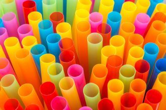 Closeup of Colorful drinking straws background.