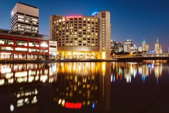 Crowne Plaza Melbourne on the waterfront at night.