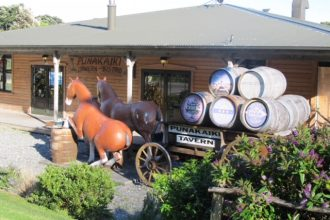 Front of the Punakaiki Tavern, with a model horse-drawn cart.