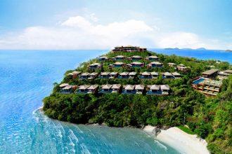 Phuket Pool Villa Phuket Sri Panwa Luxury Hotel sitting on top of a beach, in the Thailand sun.