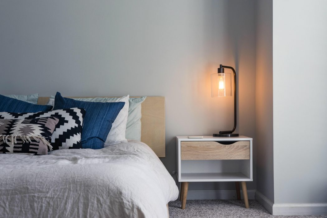 Pretty soft lamp sits on a bedside table