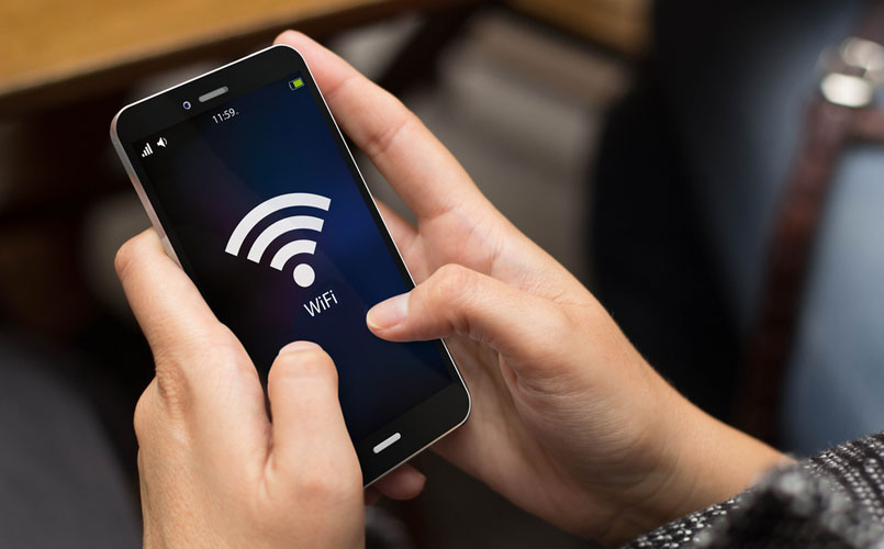 Person connecting to WiFi on their phone.