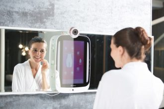 Girl using HiMirror