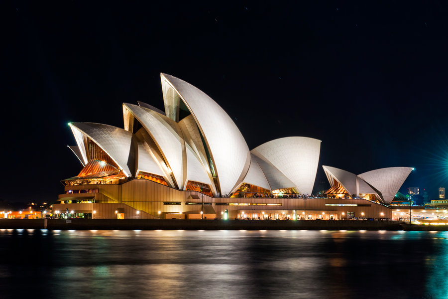 Sydney Opera House and waterfront at night.