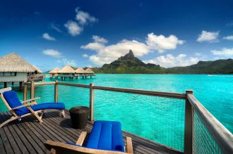 Guests look over the blue Bora Bora ocean.