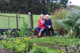 Couple sits in a farm on the Karangahake Gorge.