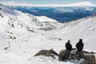 Skiers overlook the Remarkables.