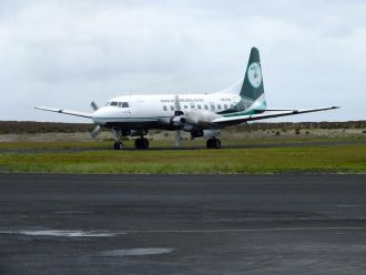Aircraft lands at Chatham Islands airport.