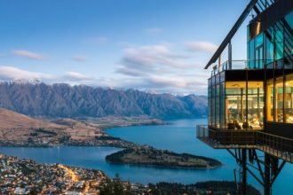Queenstown building looks over lakes.