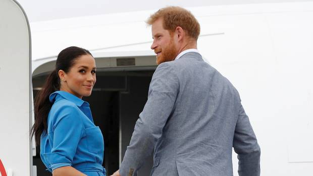 Harry and Meghan walking into a plane.