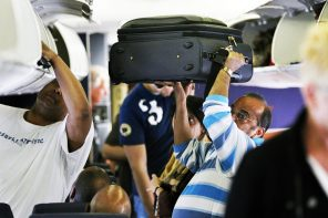 Man stows luggage on plane
