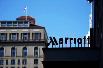 Marriott hotel looms in the shadows.
