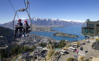 Visitors explore Queenstown NZ in a gondola.