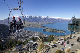 Visitors explore Queenstown NZ in a gondola.