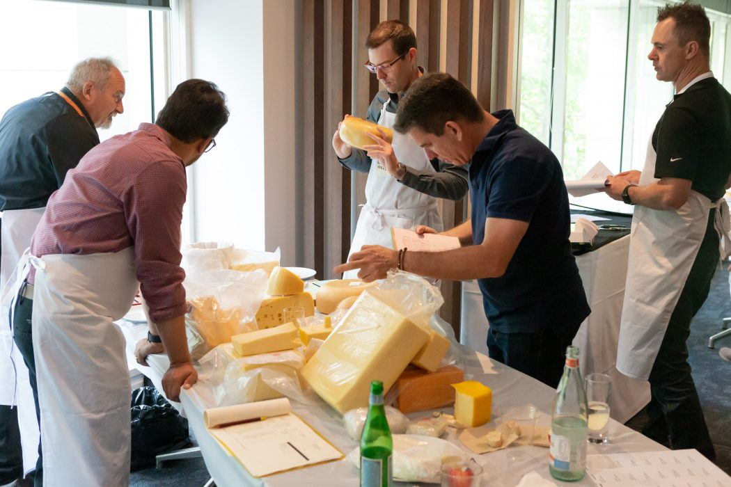 Judges assess the cheeses.