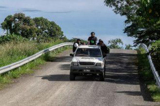 Locals ride a truck in the Solomon Islands.