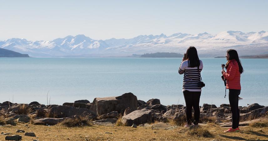 Chinese tourists enjoying the New Zealand coastline.