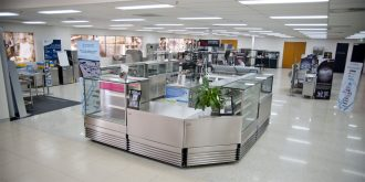 Commercial kitchen equipment sits in the middle of a showroom