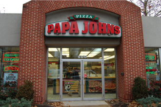 The exterior of a Papa John's pizza shop