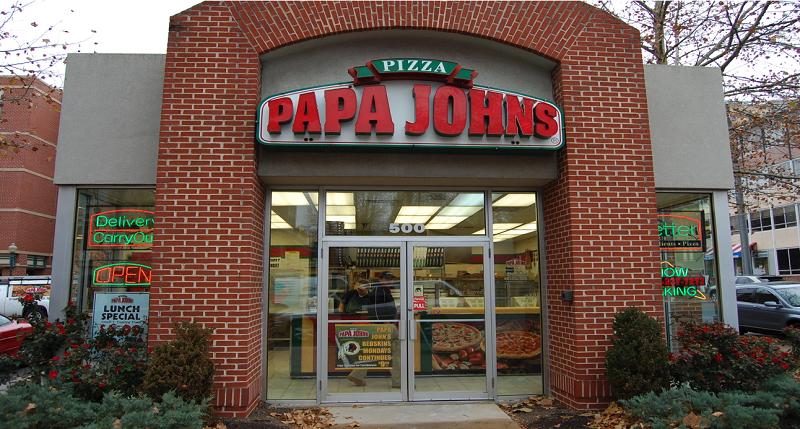 The exterior of a Papa John's pizza shop