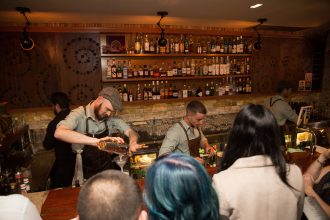 Bartenders work at Contact Bar and Kitchen in Sydney