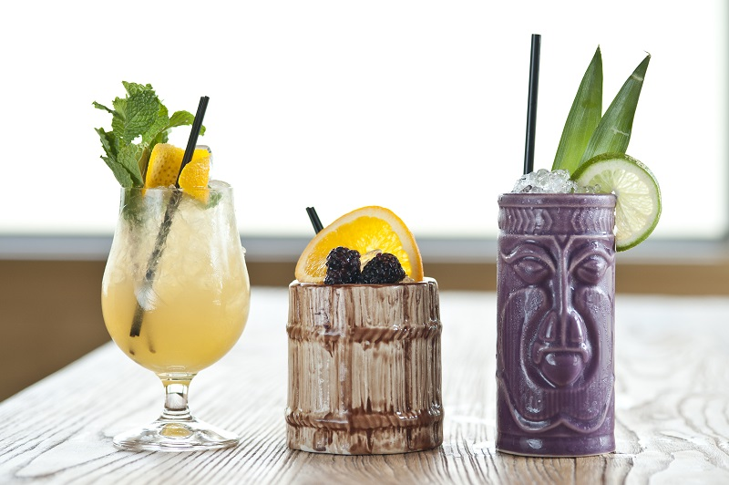 Three tiki cocktails on a table