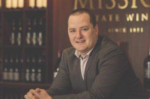 Avram Deitch at a Mission Estate Winery desk.