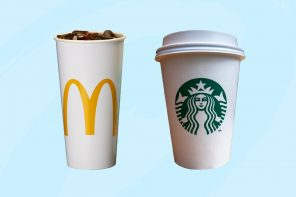 A McDonald's cup and Starbucks cup sit next to each other