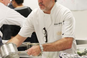 Peter Gordon prepares dishes for a Dining with a Difference event