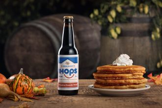 IHOP Pumpkin spice stout next to a plate of pumpkin spice pancakes