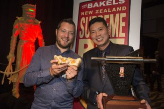 Mark Southon, Celebrity Judge (left) holding Supreme winning pie, and Patrick Lam (right), Supreme winner