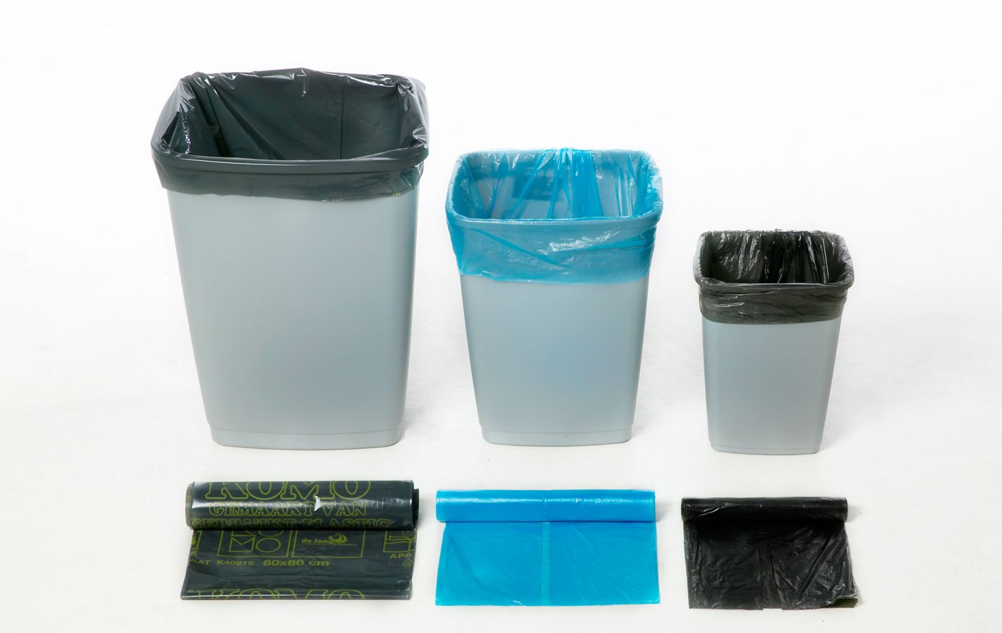 three rubbish bins of descending size, with a bin liner in each