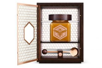 manuka south's $1800 honey jar laid in an oax box with a golden spoon