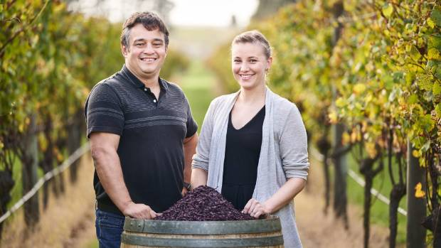Associate professor Silas Villas-Boas and doctoral candidate Ninna Granucci stand next to pinot noir pulp