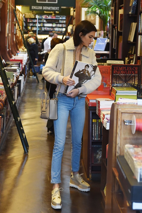 Kendall Jenner enjoys a shopping spree in a Paris bookstore, reportedly spending over £840.