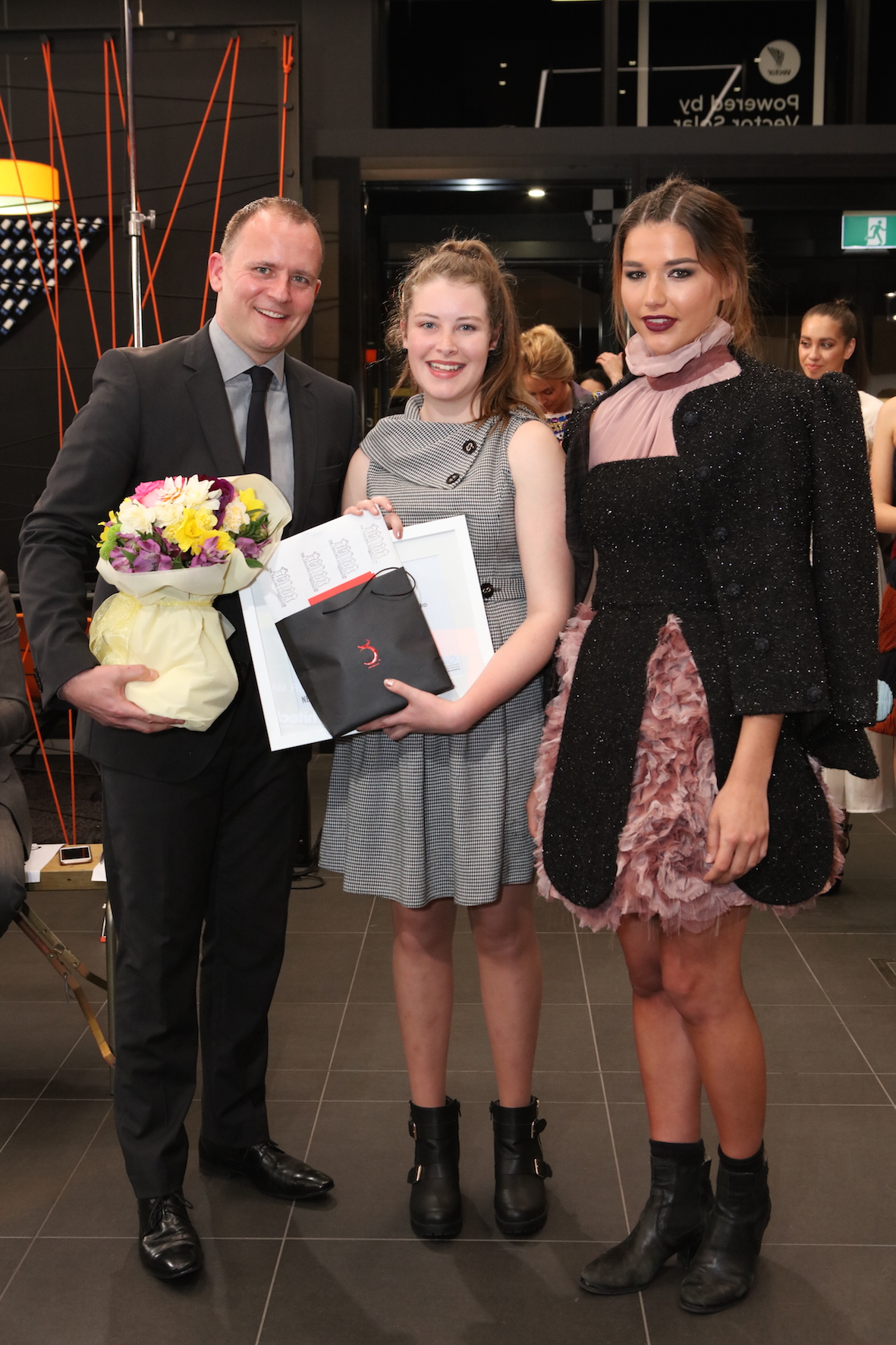 Newmarket Business Association CEO Mark Knoff-Thomas and Junior Category Winner Jodi Walker with her Red 11 Model