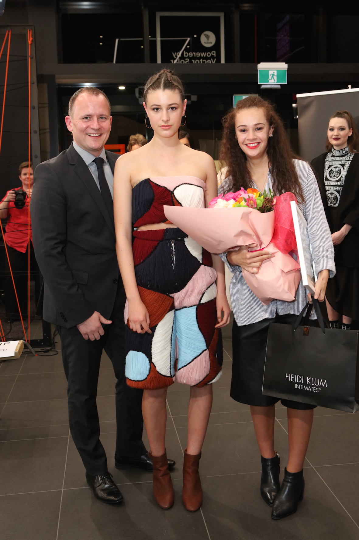 Newmarket Business Association CEO Mark Knoff-Thomas and Senior Category Winner Abi Barnes with her Red 11 Model