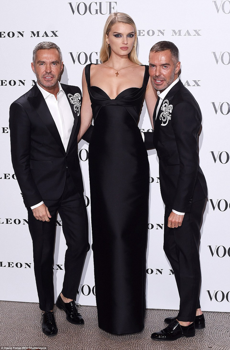 Lily Donaldson with Dean and Dan Caten celebrating 100 years of British vogue.