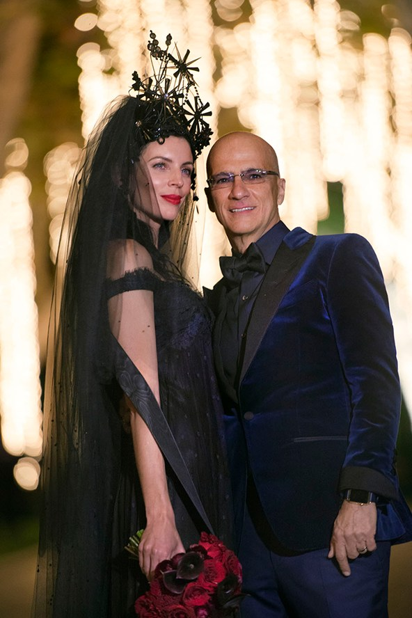 A photograph is released of Liberty Ross's wedding to Jimmy Iovine, at which the bride wore a vintage Givenchy Haute Couture gown in navy and black, with a Stephen Jones headpiece.