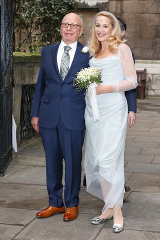 Rupert Murdoch and Jerry Hall, wearing Vivienne Westwood, smile as they leave St Bride's Church as they celebrate their marriage in the presence of friends and family following yesterday's civil ceremony.