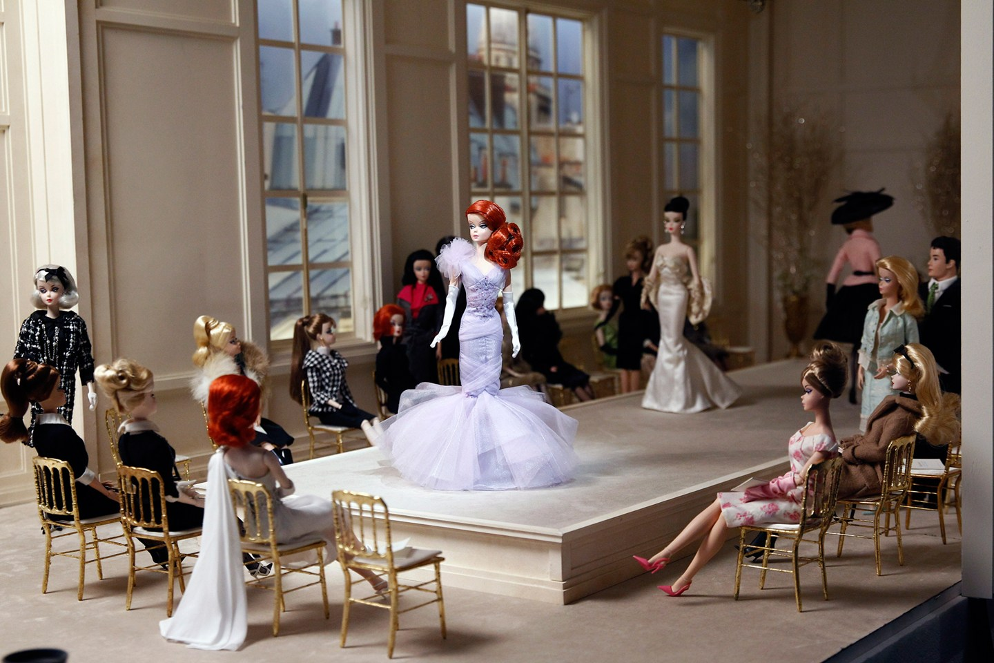 Barbie dolls are displayed at the Museum of Decorative Arts's exhibition Barbie, life of an icon, as part of Paris Fashion Week