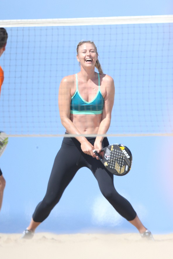 Maria Sharapova is pictured playing tennis in Nike despite the brand announcing that it was suspending its $8.5 million a year deal with Sharapova.