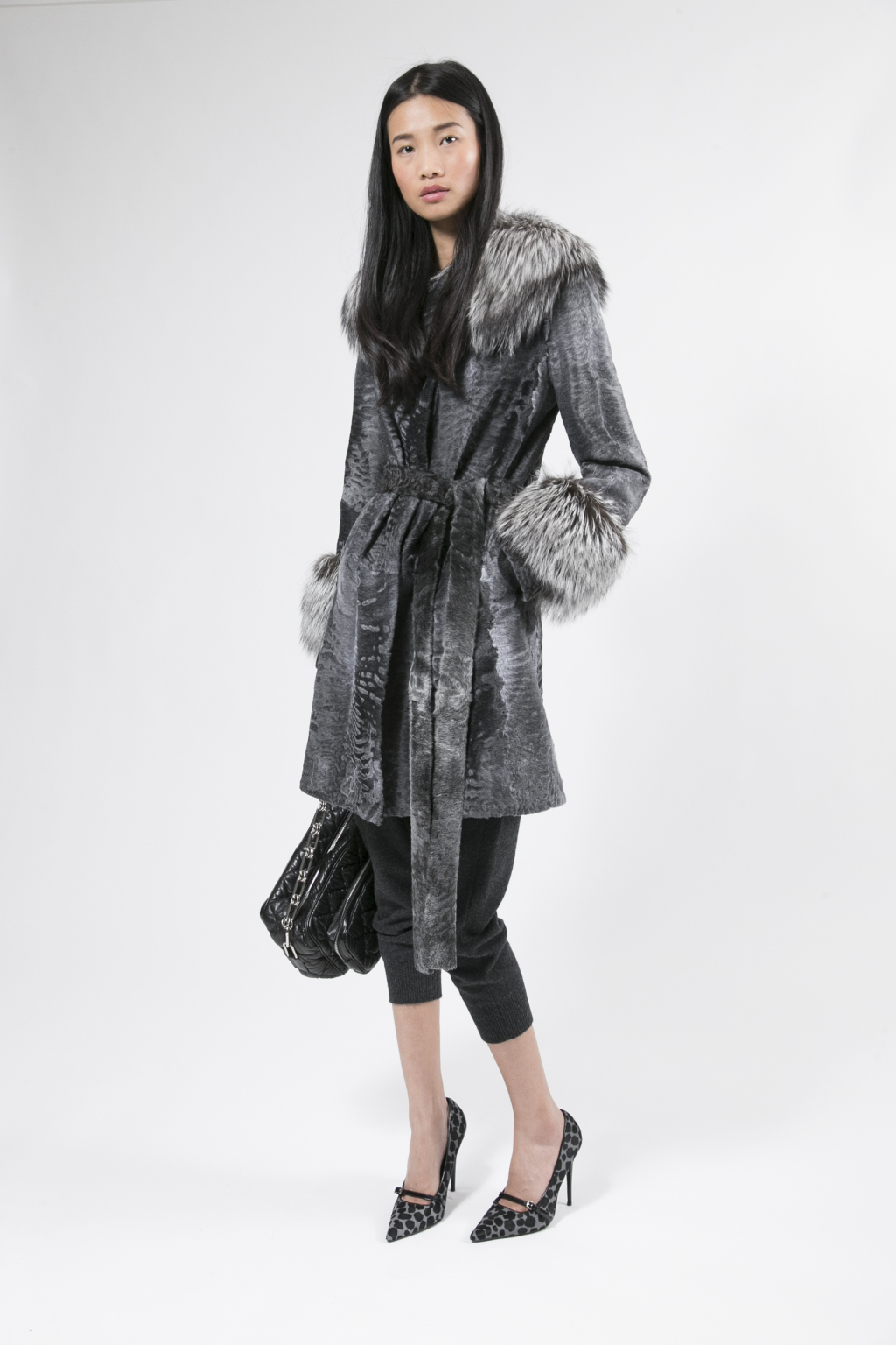 Michael Kors Collection Furs 2016 - Diversity came in silhouettes that ranged from sleek (a long vest in fawn lamb with cross fox trim) to abundant (a glorious fluff of Arctic blue fox).