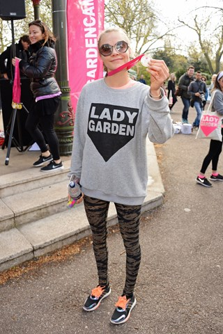 Cara Delevingne is photographed with her medal having completed the Lady Garden 5K Fun Run in aid of Silent No More Gynaecological Cancer Fund in Battersea Park.