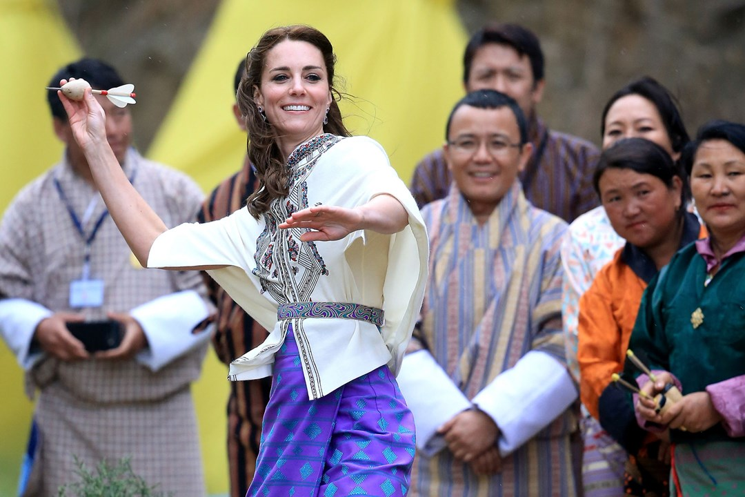 The Duchess of Cambridge throws a dart as she participates in the traditional game of Khuru at the Changlimithang Archery Ground.