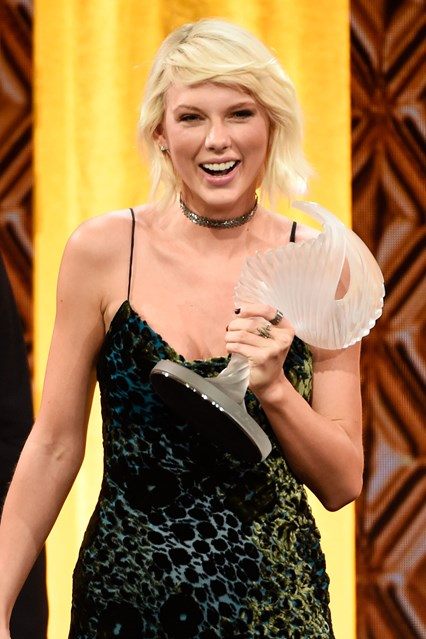 Taylor Swift accepts an award at the BMI Pop Awards in Beverly Hills.