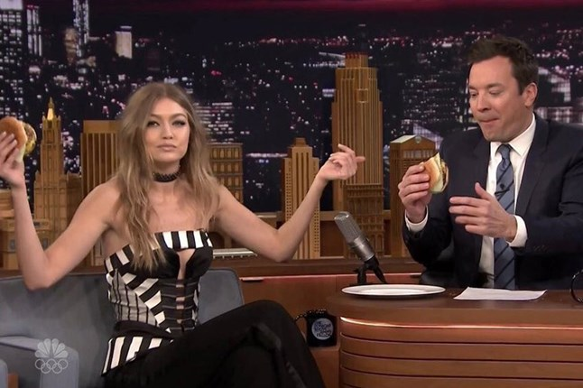 Gigi Hadid features on The Tonight Show Starring Jimmy Fallon and tucks into a burger after revealing her favourite go-to burger joint in New York. The model also disclosed how she spent the week after her 21st in Las Vegas with boyfriend Zayn Malik.